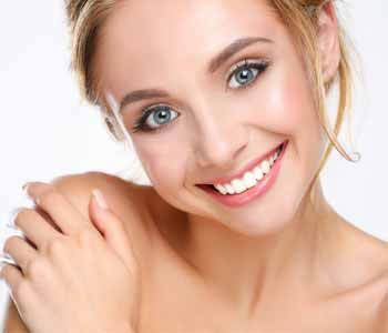 Beautiful woman smiling at the camera showing white teeth
