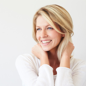 Portrait of blonde woman smiling showing white teeth
