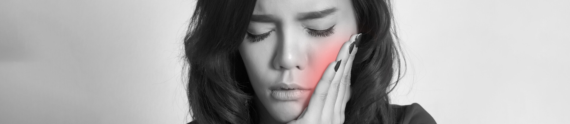 Woman in pain touching her cheeks