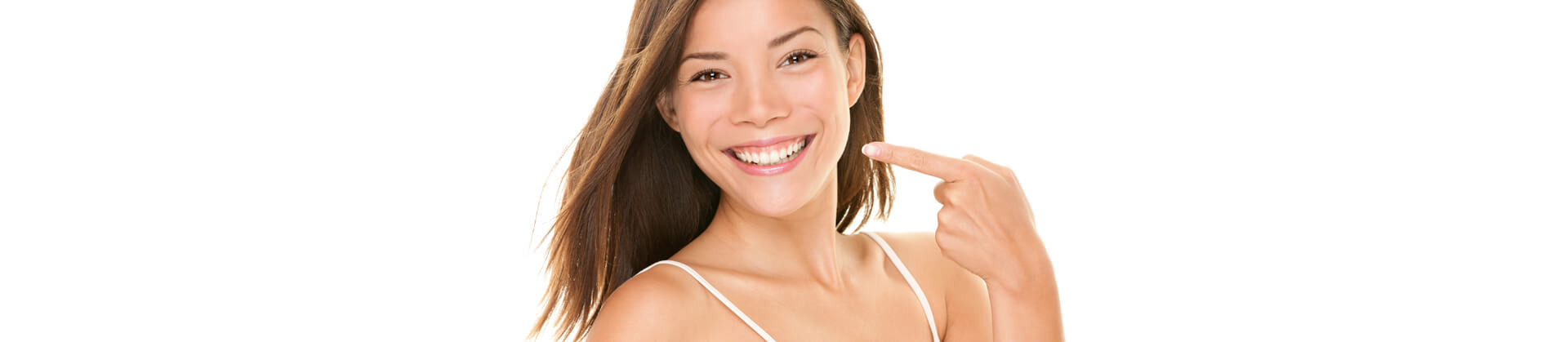 Happy woman smiling and pointing finger to her bright white teeth
