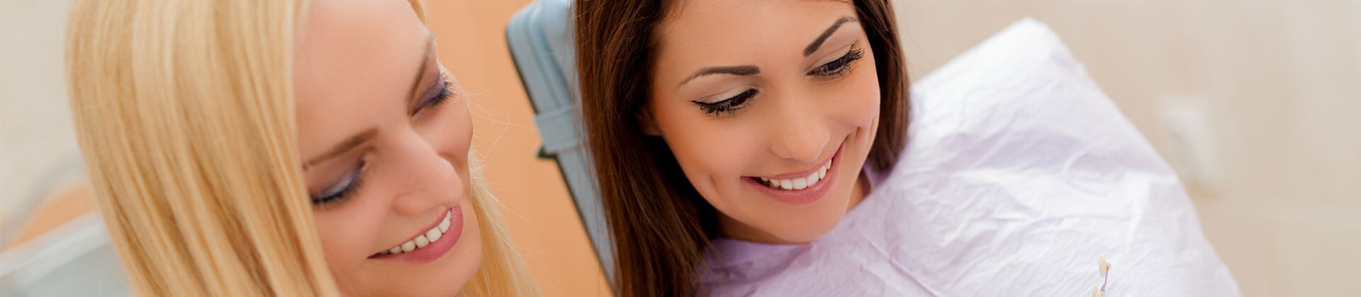 Cropped view of Dental assistant and patient smiling