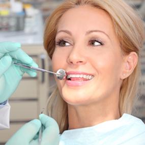 Woman receiving dental treatment at dental office