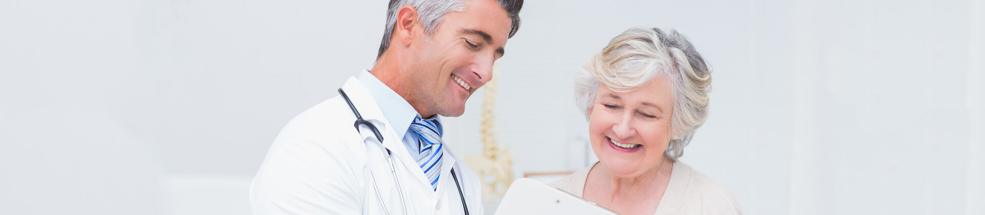 Cropped view of Doctor and patient discussing over reports